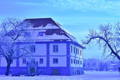 Celje Slovenia Renovated Old Building. City Celje, Slovenia, Europe, December 2017: renovated old building. In monochrome. Beautiful building in snowy winter Stock Image