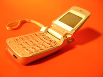 Cell 1. Cell phone on red/orange background stock images