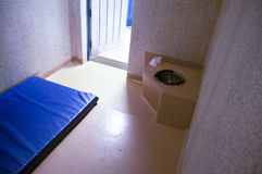 Cell. A naked prison cell with a mattres and a toilet stock image