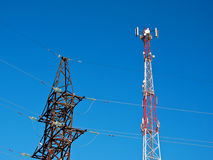 Cell antenna, transmitter. Telecom TV radio mobile tower against blue sky Royalty Free Stock Image