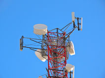 Cell antenna, transmitter. Telecom TV radio mobile tower against blue sky Royalty Free Stock Photos
