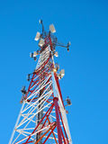 Cell antenna, transmitter. Telecom TV radio mobile tower against blue sky Stock Photography