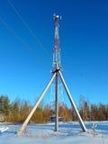 Cell antenna, transmitter. Telecom TV radio mobile tower against blue sky Stock Photo