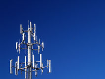 Cell Bank. A bank of cell phone towers against a blue sky Stock Photography