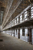 Cell block of the inside of an old prison Stock Photo