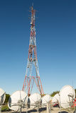 Cell Communication Tower. With telco equipment and sattelite dishes at the bottom Stock Images