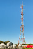 Cell Communication Tower. With telco equipment and sattelite dishes at the bottom Stock Photography