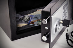 Cell with dollars. Open cell with dollars in safety deposit box Stock Images