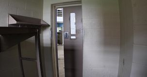 Cell door opening with sound. Inside cell in prison with door opening or unlocking with sound stock video footage