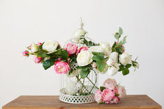Cell full of rose flowers on a wooden table Stock Images
