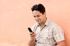 Cell or mobile phone. Happy hispanic man with cell or mobile phone Royalty Free Stock Photography