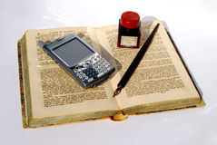 Cell over old book Royalty Free Stock Images