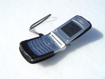 Cell phone. With snow as the background Royalty Free Stock Image