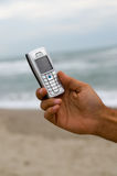 Cell phone. Close up of a cell phone with the sea as a defocused background Stock Photos