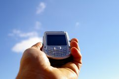 Cell phone. On clouds background Royalty Free Stock Image