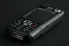Cell phone. Photo on black background Stock Image