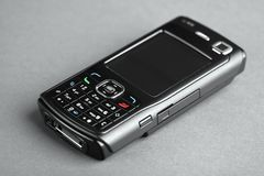 Cell phone. Photo on grey background Stock Photo