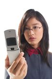 Cell phone. Beautiful Asian girl looks at mobile phone screen stock photo