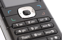 Cell phone. Closeup shot of a black mobile phone royalty free stock images