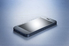 Cell Phone. A cell phone on a modern industrial surface Stock Photography