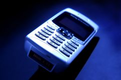 Cell phone. On blue background Royalty Free Stock Images