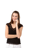 Cell Phone. Young twenty something woman is on her cell phone looking up and off as she smiles Royalty Free Stock Photos