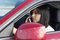 Cell phone. A cute teen driving on cell phone Royalty Free Stock Photography