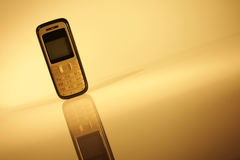 Cell phone on abstract background Stock Image