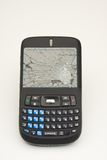 Cell Phone Abuse. Cell phone with shattered screen centered on white background verticle royalty free stock photo