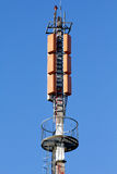 Cell phone antenna. Over a blue sky background Stock Photos