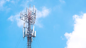 Cell phone antenna with blue sky and could with copyspace. Communication cell phone and background concept - Cell phone antenna with blue sky and could with Royalty Free Stock Photography