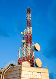 Cell phone antenna system. Large transmission poles. Royalty Free Stock Image
