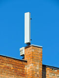 Cell phone antenna, transmitter. Telecom radio mobile antenna against blue sky Royalty Free Stock Images
