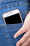 Cell phone in back pocket of girl's jeans Royalty Free Stock Photos