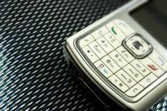 Cell phone on black. White cell phone on black background Royalty Free Stock Photo