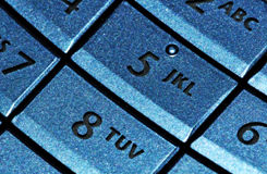 Cell phone blue keypad Royalty Free Stock Photo