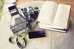 Cell phone, books and old photo camera Royalty Free Stock Photo