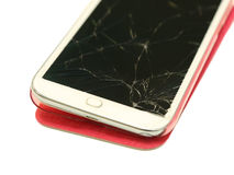 Cell phone with broken screen Royalty Free Stock Photos