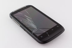 Cell phone with a broken screen. Mobile cell phone with a broken screen royalty free stock photos