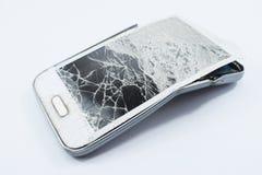 Cell phone broken, on white background. Broken royalty free stock image