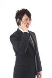 Cell-phone and businessman Stock Image