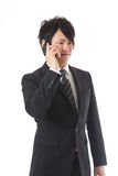 Cell-phone and businessman Stock Photography