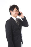 Cell-phone and businessman Royalty Free Stock Photos