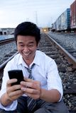 Cell Phone Call on Train Tracks Royalty Free Stock Photography