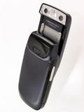 Cell phone camera. Black mobile phone and camera royalty free stock images