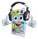 Music app cell phone. A cell phone cartoon mascot with big headphones on listening to music and giving a double thumbs up Royalty Free Stock Photo