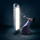Cell phone chains. A woman is bound by chains to her cell phone Royalty Free Stock Image