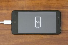 Cell Phone Charging royalty free stock images