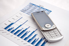 Cell Phone on Chart Stock Images