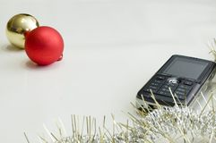 Cell phone and christmas ball Royalty Free Stock Image